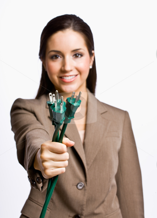 Businesswoman  holding electrical plugs stock photo, Businesswoman  holding electrical plugs by Jonathan Ross