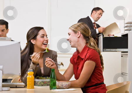 Businesswomen eating salad for lunch stock photo, Businesswomen eating salad for lunch by Jonathan Ross