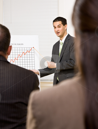 Businessman explaining chart stock photo, Businessman explaining chart by Jonathan Ross