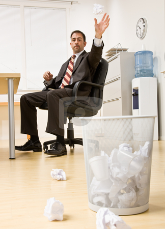 Businessman throwing paper in trash basket stock photo, Businessman throwing paper in trash basket by Jonathan Ross