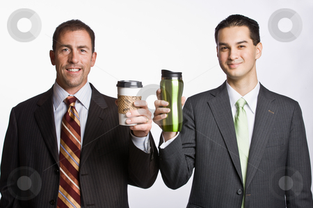 Businessmen holding coffee cups stock photo, Businessmen holding coffee cups by Jonathan Ross