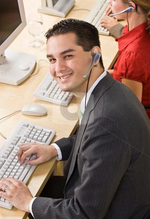 Businessman talking on headsets stock photo, Businessman talking on headsets by Jonathan Ross