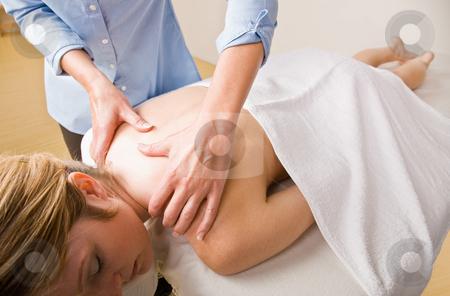 Massage therapist giving woman massage stock photo, Massage therapist giving woman massage by Jonathan Ross