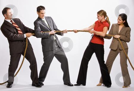 Business people playing tug-of-war stock photo, Business people playing tug-of-war by Jonathan Ross