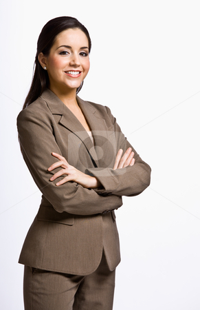 Businesswoman smiling with arms crossed stock photo, Businesswoman smiling with arms crossed by Jonathan Ross
