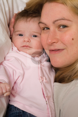 Mom and daugther stock photo, Portrait of a mother and her baby daugther being close together by Yann Poirier