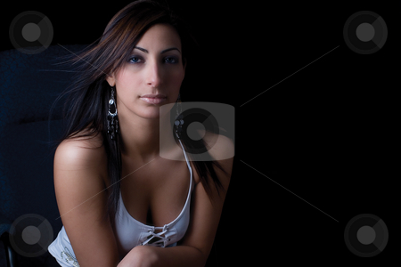 Sexy corporate stock photo, Twenty something fashion model sitting on office chair looking very calm attitude by Yann Poirier