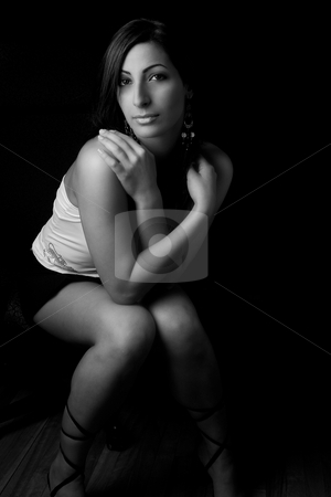 Hidding in arm stock photo, Black and white portrait of a twenty something fashion model hidding behind her arms by Yann Poirier
