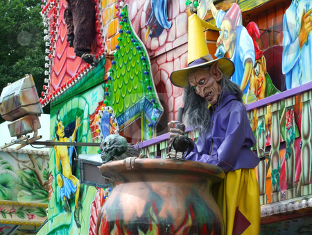 Purple witch stock photo, Colourful witch figure in a amusement park by Birgit Reitz-Hofmann
