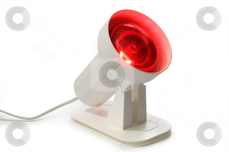 Infrared lamp stock photo, Warming lamp for the light therapy on bright background by Birgit Reitz-Hofmann