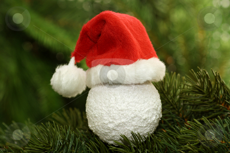 Santa claus cap stock photo, Christmas tree ball with santa claus cap  on green background by Birgit Reitz-Hofmann