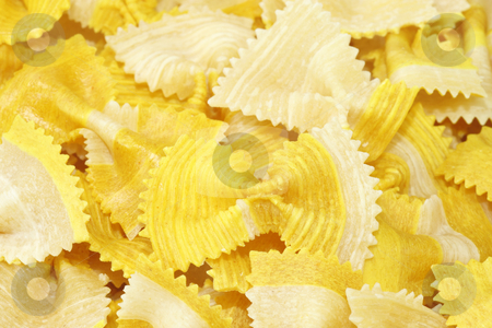 Noodles stock photo, Yellow noodles close up, background. by Birgit Reitz-Hofmann