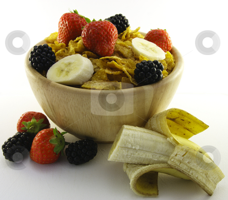 Cornflakes and Fruit in a Wooden Bowl stock photo, Cornflakes with strawberries, blackberries and banana in a round wooden bowl on a white background by Keith Wilson