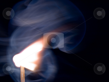 Match stick igniting stock photo, Close up of igniting match  and smoke 