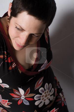 Pregnant women stock photo, Top view portrait of a late twentie pregnant woment by Yann Poirier
