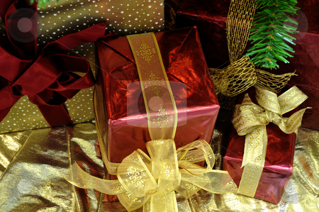 Christmas Gifrts stock photo, Gold and red wrapped Christmas gifts by Lynn Bendickson