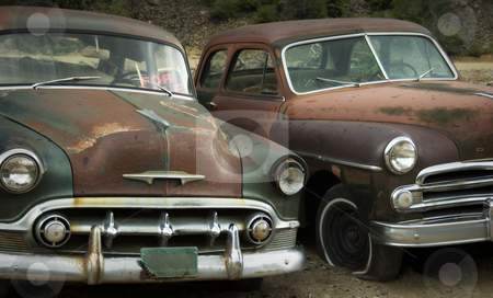 Old Friends Rusting at the Junkyard FOR SALE stock photo, Old rusted cars in the rain at the junkyard looking sad. Good for themes of transportation, retirement, change, aging, retro, nostalgia, memories, family, friendship, humor. by Jeff DeMent