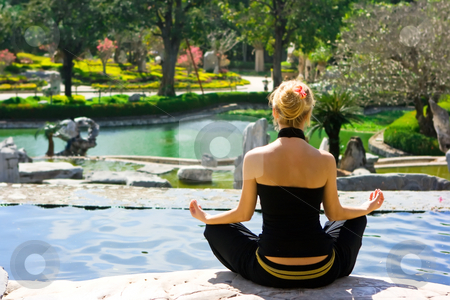 Meditation stock photo, Meditating blonde girl in the tropical park by Dmitry Rostovtsev