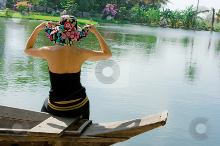Girl in hat stock photo, Girl in flower hat on the boat by Dmitry Rostovtsev