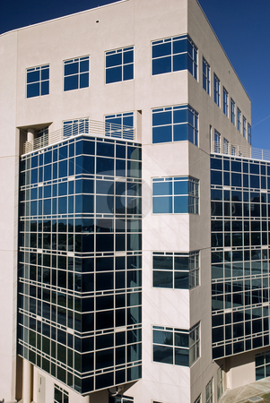 Angles Lines and Glass stock photo, Ultra modern building with angles, glass, and lines. by Charles Buegeler