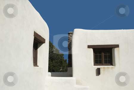 Adobe Walls stock photo, White adobe walls of the hotel highlighted against a blue sky. by Charles Buegeler
