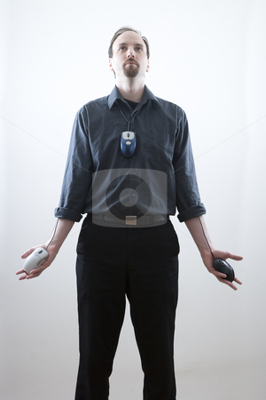 Lord of the mouse stock photo, Thirty something man standing with open palms while looking up, call on some religious imagery.  Each palm has a mouse with the wires coming from inside the shirt.  A mouse is also worned as a tie by Yann Poirier