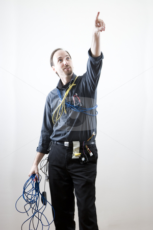 Pointing to the heaven stock photo, Computer technician pointing to the sky wearing many different kind of computer cables and wire by Yann Poirier