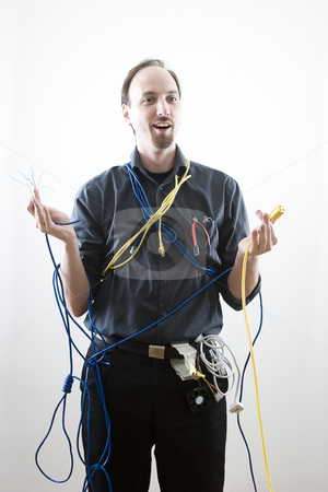 Surprise Technician stock photo, Dumb technician surprise by wires in his hand by Yann Poirier