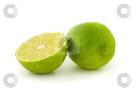 Green lime and its half stock photo, Green lime and its half isolated on white background. by Natalia Banegas
