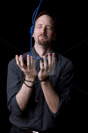 Suicidal technician stock photo, Computer technician with tied hands and hangman noeuce around his neck, pleading for mercy by Yann Poirier
