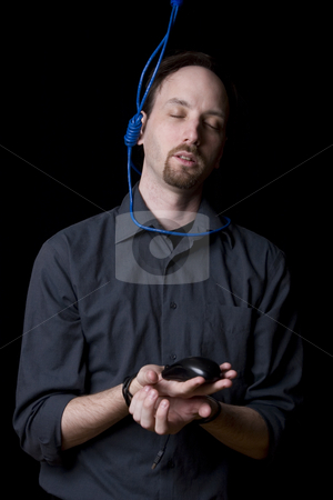 Suicidal technician Peaceful stock photo, Computer technician with tied hands and hangman noeuce around his neck, accepting his faith and closing his eyes by Yann Poirier