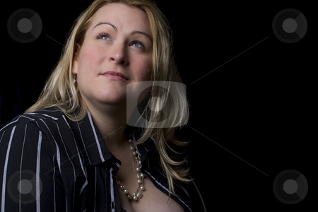 Overweight fashion model stock photo, Thirty something overweight fashion model in sexy black outfit looking up to the left by Yann Poirier