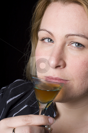 Women having a drink stock photo, Thirty something women having a glass of brown alcohol? by Yann Poirier