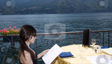 Looking at the menu stock photo, Looking at the menu at an outside restaurant in Como Italy by Daniel Kafer