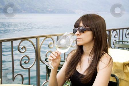 Sipping white wine stock photo, Drinking wine at an outside restaurant by Daniel Kafer