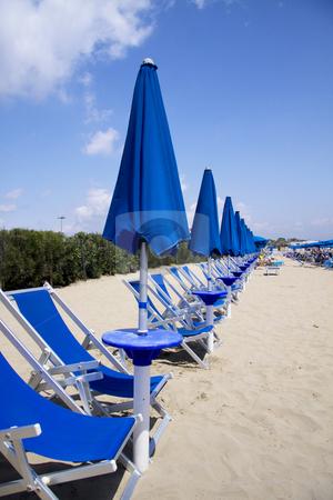 Closed beach umbrellas stock photo, Closed beach umbrellas in Terracina Italy by Daniel Kafer