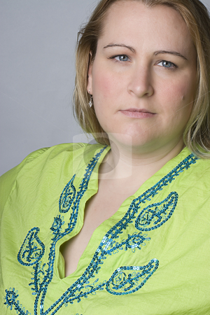 Overweight model stock photo, Thirty something overweight women in green top by Yann Poirier