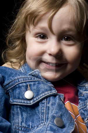 Two year old boy with a big smile stock photo, Portrait of a two year old boy wearing a jean jacket with a big smile by Yann Poirier
