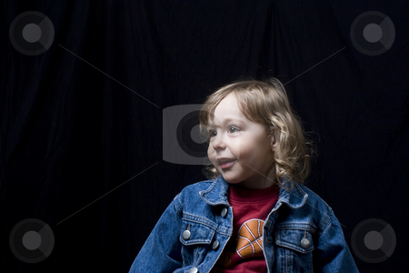 Toddler looking aways stock photo, Portrait of a two year old boy wearing a jean jacket looking aways to the left by Yann Poirier