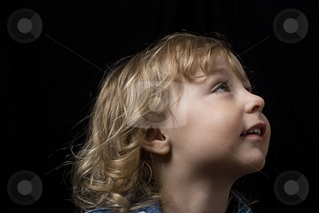Toddler looking up stock photo, Portrait of a two year old boy wearing a jean jacket looking up to the right by Yann Poirier