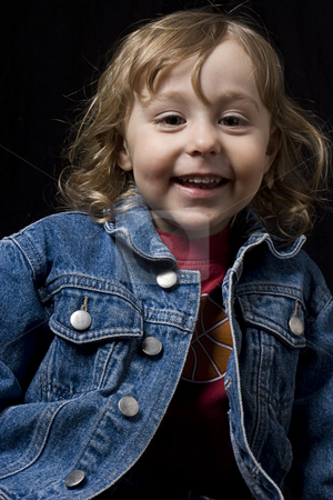 Toddler smiling stock photo, Portrait of a two year old boy wearing a jean jacket with great big smile by Yann Poirier