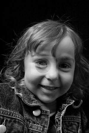 Toddler smiling stock photo, Black and white portrait of a two year old boy wearing a jean jacket with great big smile by Yann Poirier