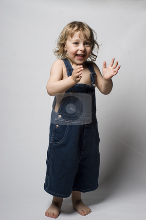 Toddle in overall clapping stock photo, Two year old toddler wearing a jean overall clapping to a beat by Yann Poirier