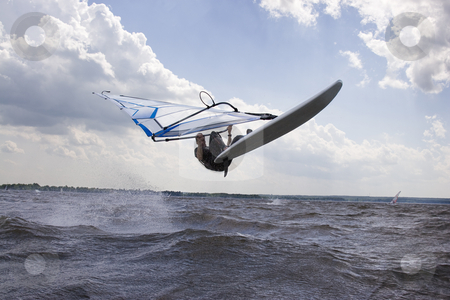 Windsurfer doing a nose landing stock photo, Windsurfer in mid air doing a jump call nose landing by Yann Poirier