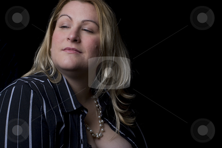 Snobing the camera stock photo, Full figure women in evening clothes snobing the camera by Yann Poirier