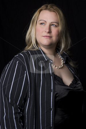 Overweight women in evening ware stock photo, Portrait of a thirty something overweight women in evening clothes by Yann Poirier