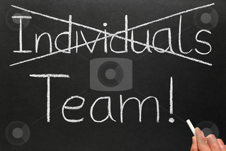 Crossing out individuals and writing team on a blackboard. stock photo, Crossing out individuals and writing team on a blackboard. by Stephen Rees