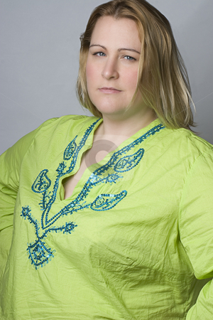 Overweight women in wrinkle shirt stock photo, Full figure women in casual clothes by Yann Poirier