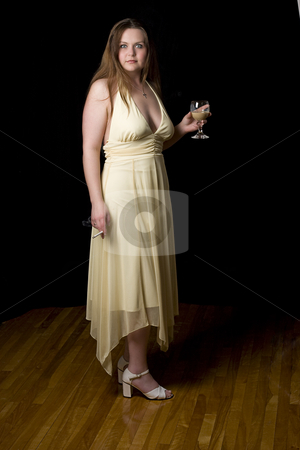 Drinking and smoking stock photo, Twenty something girl in yellow evening dress with cigarette and drink in her hand by Yann Poirier