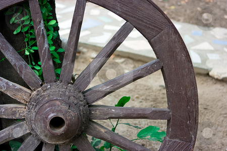 Wheel stock photo, Wood old carriage wheel used as decoration by Dmitry Rostovtsev